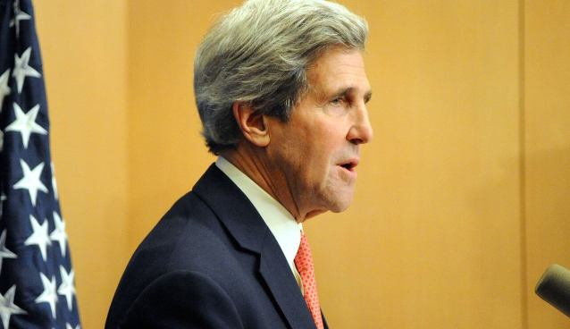 U.S. Secretary of State John Kerry answers questions from his traveling press crops about Middle East peace negotiations, Iraq, and Syria before departing Jerusalem and Israel for further talks in Jordan and Saudi Arabia on January 5, 2014.
