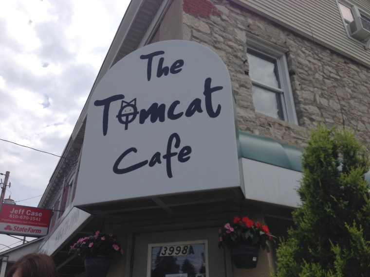 Sign above the entryway of The Tomcat Cafe.
