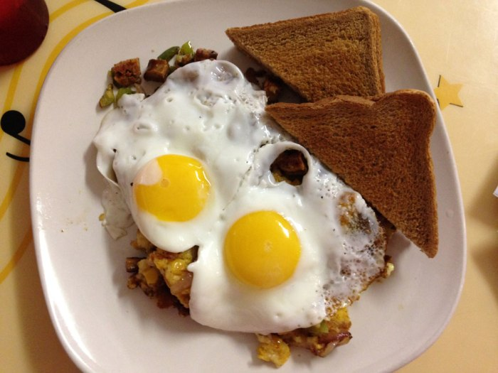 cd-s-place-two-eggs-over-baked-corn-andouille-hash