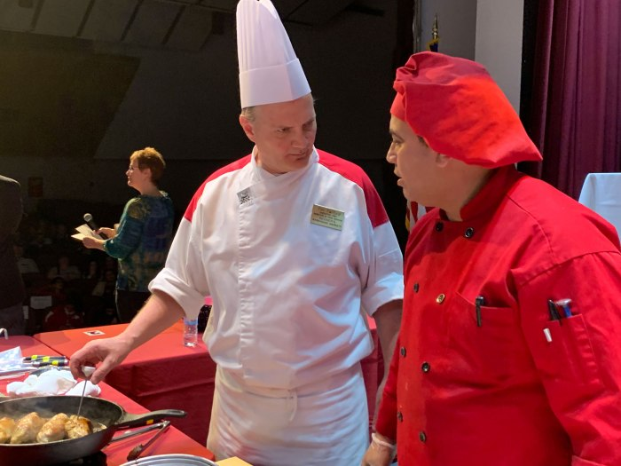 Chef Tim and his sous chef discussing their gameplan