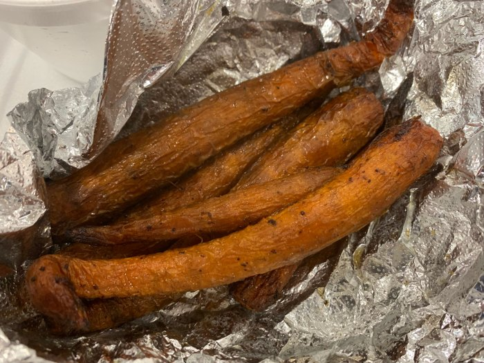 The barbecue carrots were were rolled in aluminum foil to keep them hot.