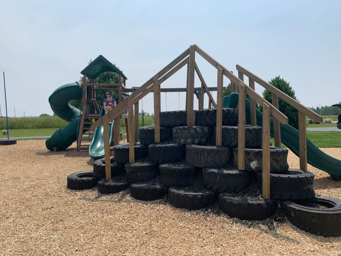 Patches' playground features a tire climb, swings and two large slides.