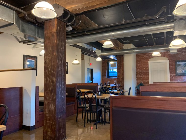 Booths and tables are laid out among exposed beams inside the brick walls of Fratello's in Reading