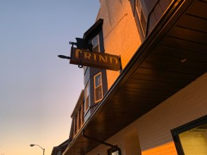 The exterior of Grind Restaurant, Boyertown, at twilight