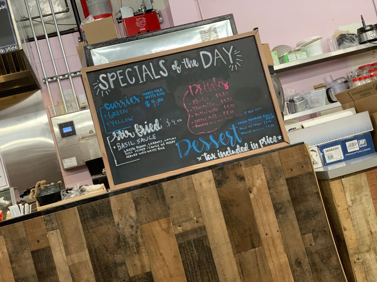 The Specials of the Day sign at Eve's Thai Kitchen with menu items written in colored chalk