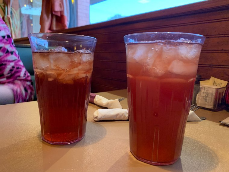 Two glasses of rose iced tea on a table at Aladdin Mediterranean Restaurant