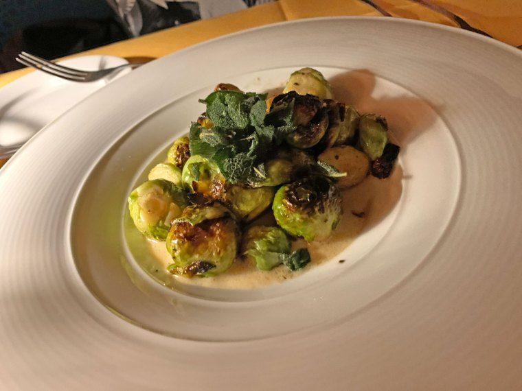 A plate of Brussels sprouts in a white truffle cream sauce from Judy's on Cherry