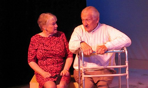 """(L to R) Joan Coombs and John Noble  in """"Better LAte"""" at the Theater Barn."""