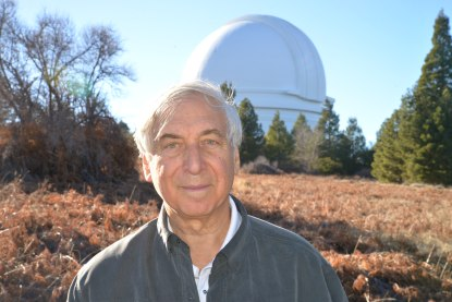 Williams College Professor Jay Pasachoff with Williams College's Hopkins Observatory, which he directs, in the background.