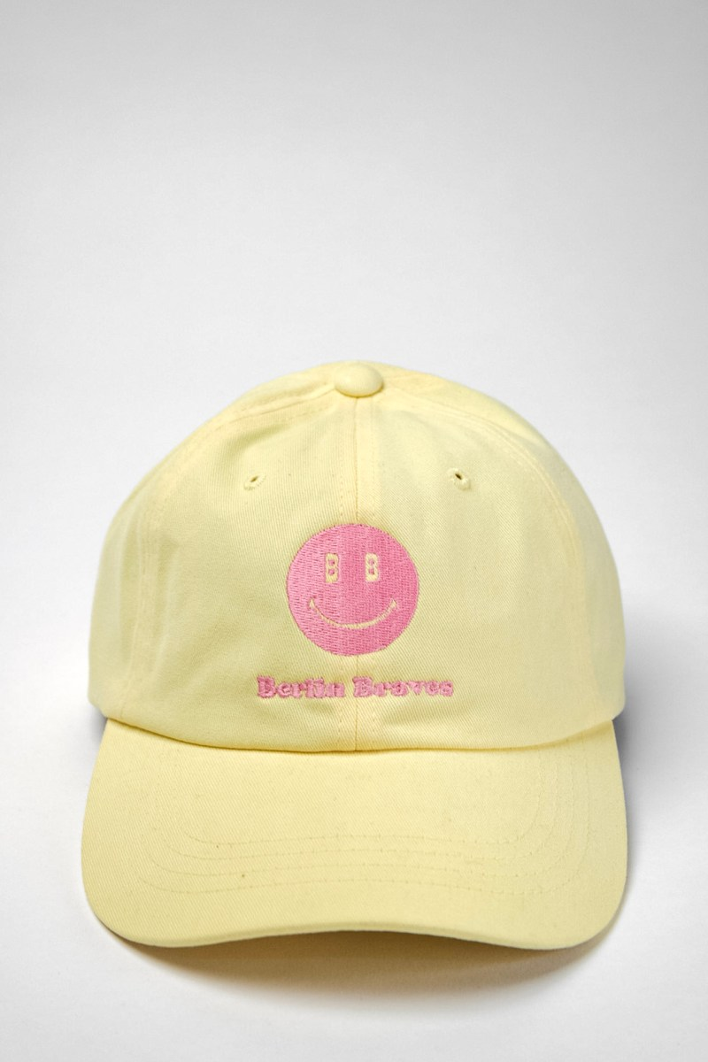 yellow dad hat pink smiley berlin braves