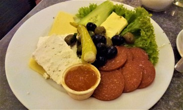 """My breakfast called """"Tausend und eine Nacht"""" with olives, sheep cheese, some other sorts of cheese, salami, butter, marmalade, sweet pepper, cucumber, and salad"""