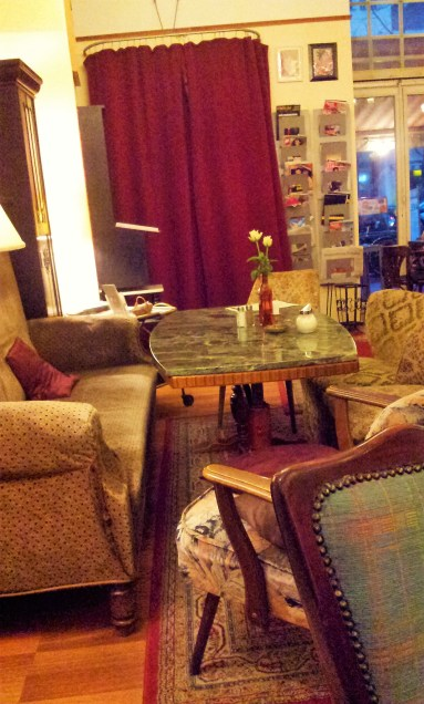 The sofa and its couch chairs in the front room
