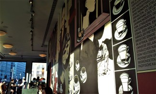 The art on the wall of the wing towards the sunny glass front at Potsdamer Platz
