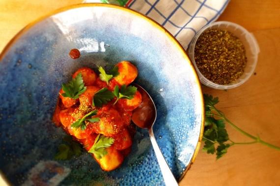 gnudi in tomato sauce, ricotta gnocchi in tomato sauce