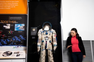 Soyeon Yi made headlines in 2008 as Korea's first astronaut, where she conducted research for 10 days at the International Space Station. Yi stands by a space suit similar to what she wore. Today, she volunteers at The Museum of Flight Charles Simonyi Space Gallery and lives southeast of Seattle in an area she says reminds her of the farmland on which she grew up. Photo by Daniel Berman for Cosmopolitan.com
