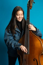 Bassist Colby Lamson-Gordon is a junior at Lakeside School in Seattle. Lamson-Gordon is part of an all-girls jazz ensemble group closing in on a chance to perform in the prestigious Essentially Ellington competition. KUOW Photo/Daniel Berman