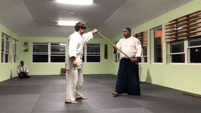 Eugene demonstrates how nikkyo using the jo is the same movement as the open hand nikkyo we are more used to