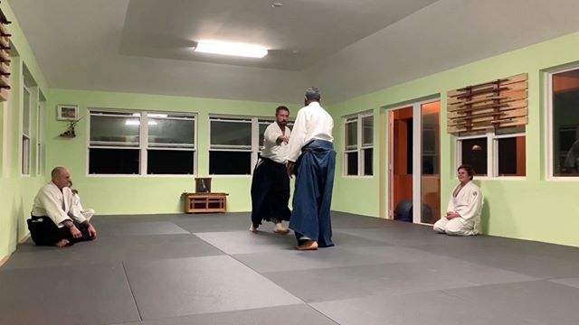 """Sensei Smith demonstrates """"irimi nage"""" from a cross-hand grab with a couple of variations. Chris' job is to hang on!"""