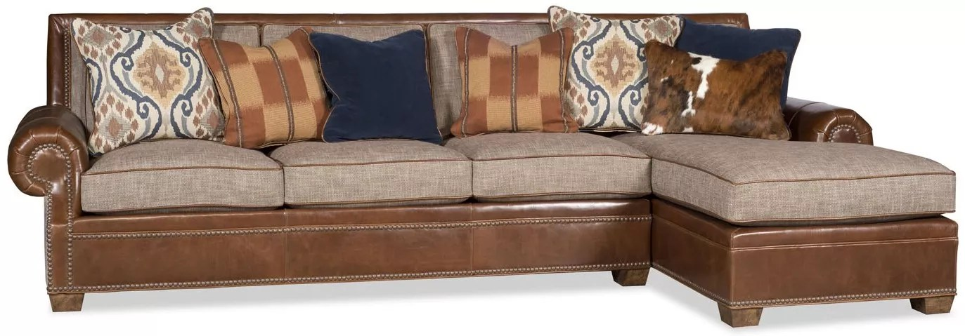 sectional sofa covered in a combination of leather and fabric