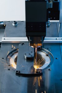 Laser welding a synchronous wheel onto a gear. The EMAG fiber laser on the ELC 160 saves 50% in operating costs.