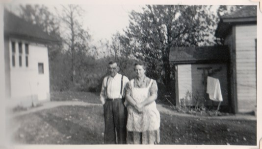 Tom and Harriett Berrett behind their home - 1944