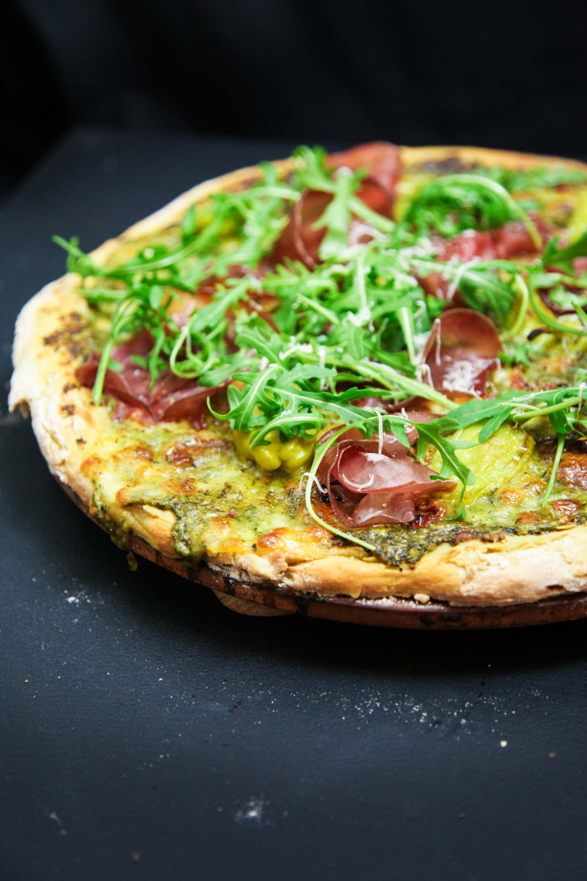 Wild Garlic Pesto Pizza with Bresaola and Arugula   Berries and Spice