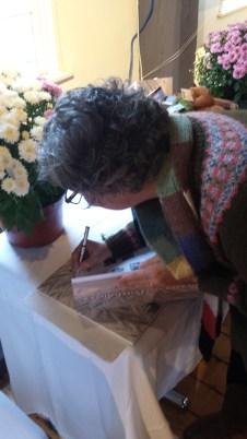 Ellen autographs a copy of Portfolio.