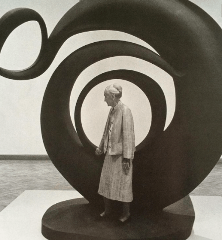 "Georgia in front of her piece ""Abstraction"" 1945"
