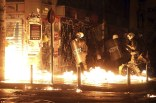 3a69b55100000578-3937566-police_try_to_detain_protesters_throwing_flame_bombs_and_demonst-a-1_1479247706519