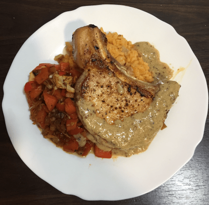 Pan sauce on pork chops with spicy carrots and rice