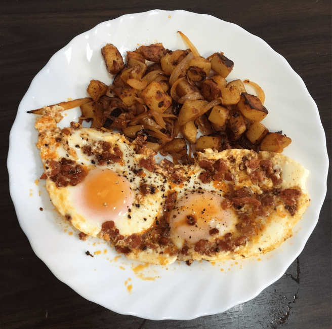 """""""Crowd Pleaser"""" sautéed onions and potatoes with chorizo eggs sunny side up"""