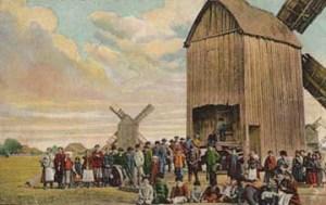 koloriertes Foto: vielen Menschen vor zwei großen Mühlen