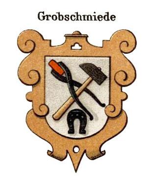 Handwerkswappen: orangener ornamentaler Rand, auf hellorangenem Grund sich kreuzender Hammer mit Zange nebst Eisenstück