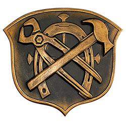 Handwerkszeichen aus Messing: Zange, Hufeisen, Hammer