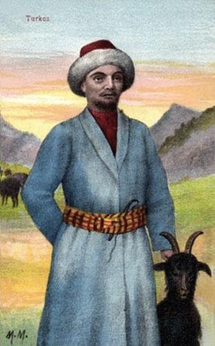 Ziegenhirt in langem blauen Mantel in den Bergen ein schwarze Ziege an seiner Seite