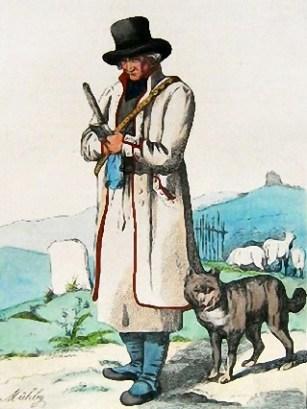 Schäfer in weißem Mantel mit seinem Hütehund