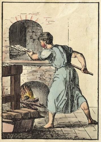 Bäcker schiebt Gebäck in den Backofen