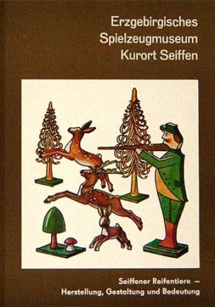 Heftcover: Holzfiguren zum Thema Jagd