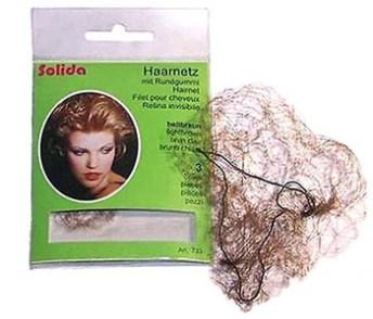 Farbfoto: hauchzartes Haarnetz neben Verpackung