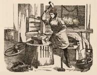 Kupferstich: Dorfschmied bearbeitet Hufeisen, am Boden liegen Werkzeuge, ein Wagenrad und Ketten