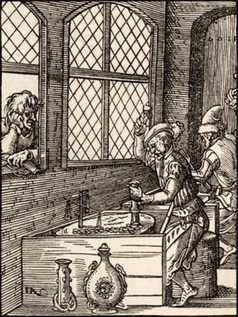 Holzschnitt: Münzmeister prägt Münzen, indem er mittels Hammer Stempel auf Rohling schlägt - 1568