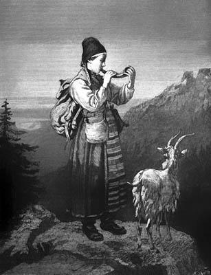 sw: Hirtin in Tracht mit Ziege in den Bergen