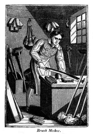 Mann in seiner Werkstatt beim Arbeiten