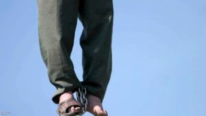 """PAKDASHT, IRAN - MARCH 16:  Iranian serial killer Mohammad Bijeh, 22, who has been convicted of kidnapping and murdering 21 people, most of them children, is hauled into the air by a crane after his executionon March 16, 2005 in Pakdasht, Iran. Bijeh, branded """"the vampire of the desert"""" in Iran, was lashed 100 times and hanged before thousands of spectators. (Photo by Getty Images)"""