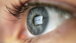 LONDON - APRIL 13:  In this photo illustration, the logo of the multi-facetted internet giant Google is reflected in the eye of a woman looking at a computer screen, April 13, 2006 in London, England.   (Photo Illustration by Scott Barbour/Getty Images)