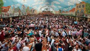 MUNICH, GERMANY - SEPTEMBER 22:  Visitors crowd the Hacker-Pschorr tent at the Oktoberfest 2013 beer festival at Theresienwiese on September 22, 2013 in Munich, Germany. The Munich Oktoberfest, which this year will run from September 21 through October 6, is the world's largest beer fest and draws millions of visitors.  (Photo by Johannes Simon/Getty Images)