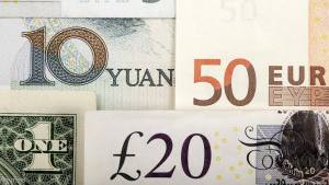 Arrangement of various world currencies including Chinese Yuan, US Dollar, Euro, British Pound, in this picture illustration taken January 25, 2011.  To match Special Report CHINA-INVESTMENT/EUROFX      REUTERS/Kacper Pempel/Illustration/File Photo