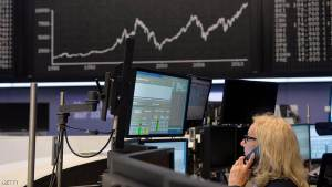 FRANKFURT AM MAIN, GERMANY - JUNE 05:  Traders speak on telephones in front of the  index board that shows the DAX index from 1988 to 2014 on June 5, 2014 in Frankfurt, Germany. For the first time ever at the Deutsche Boerse exchange the DAX has broken the 10,000 Mark. The rise comes after European Central Bank President Mario Draghi announced record low interest rates.  (Photo by Thomas Lohnes/Getty Images)