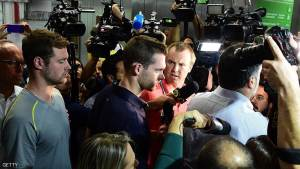 American swimmers Gunnar Bentz (L) and Jack Conger leave the police station at the Rio de Janeiro International Airport August 17th after being detained on the plane that would travel back to the US.   Jack Conger and Gunnar Bentz were taken off a flight leaving Rio de Janeiro by authorities investigating doubts over their claim to have been mugged. / AFP / TASSO MARCELO        (Photo credit should read TASSO MARCELO/AFP/Getty Images)