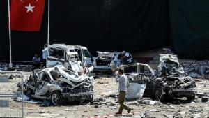 A man walks among the wreckage of vehicles as Turkish rescue workers and police inspect the blast scene following a car bomb attack on a police station in the eastern Turkish city of Elazig, on August 18, 2016. At least three people were killed and another 120 injured on August 18, 2016 in a car bomb attack on a police headquarters in eastern Turkey, a local security source said. The explosion, blamed by Defence Minister Fikri Isik on the outlawed Kurdistan Workers' Party (PKK), happened in the garden of the four-storey building in Elazig.  / AFP / ILYAS AKENGIN        (Photo credit should read ILYAS AKENGIN/AFP/Getty Images)
